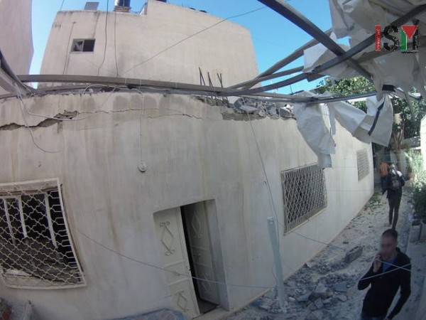 Neighbouring home at Al Rawda College St. with damaged walls, roofs and windows