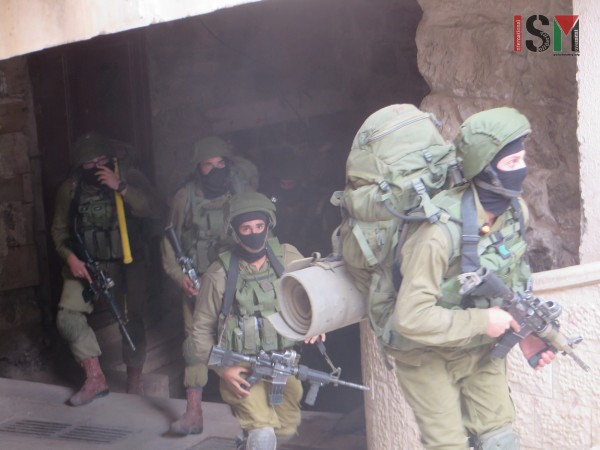 Israeli forces on their way to raid yet another Palestinian house