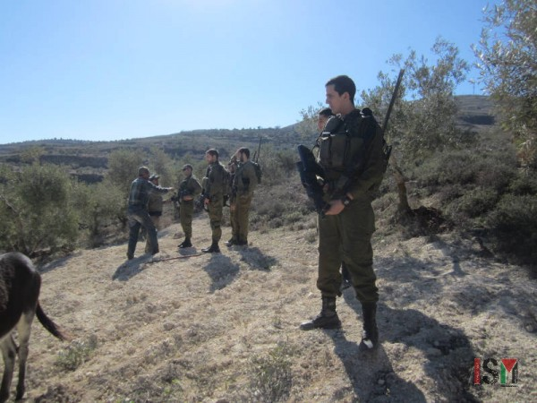 Israeli forces preventing Palestinians from reentering the field.