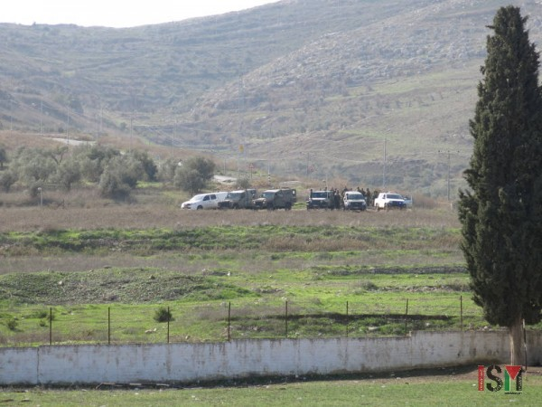 Israeli forces observing the school after the attack.