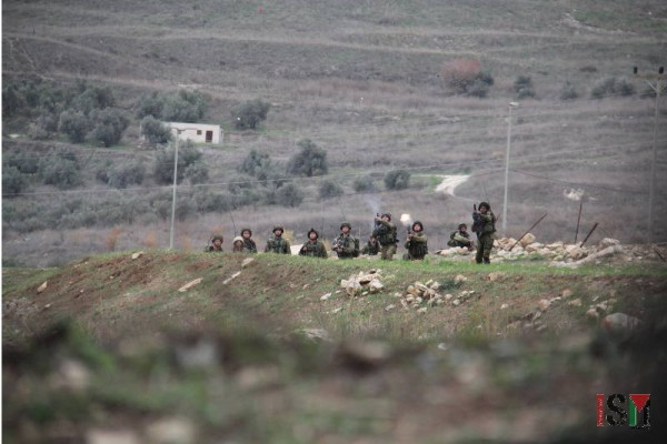 Israeli forces fire tear gas towards protesters.