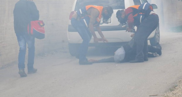 Protester suffocated after inhaling tear gas.