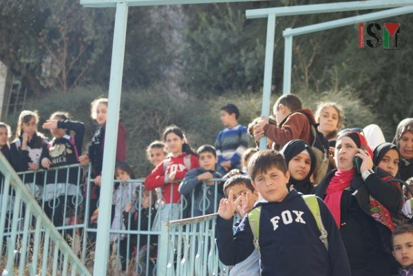 School children kept waiting on stairs by Shuhada street for nearly an hour, 1 November