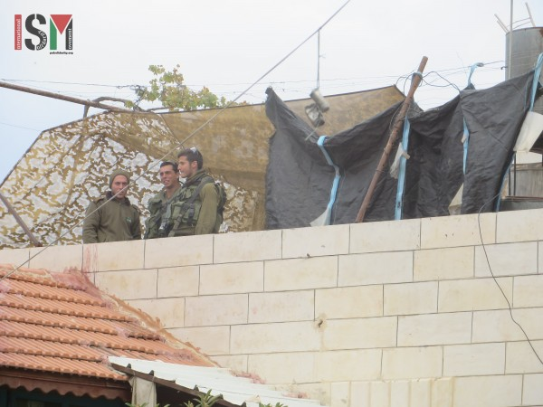 Israeli forces stationed on a family home