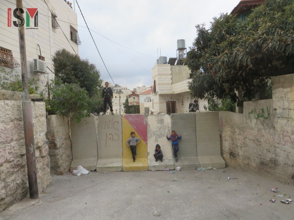 Children playing on the newly erected wall blocking off the neighbourhood