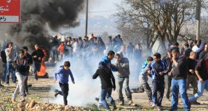 Demonstration attacked with tear gas shot by Israeli forces.