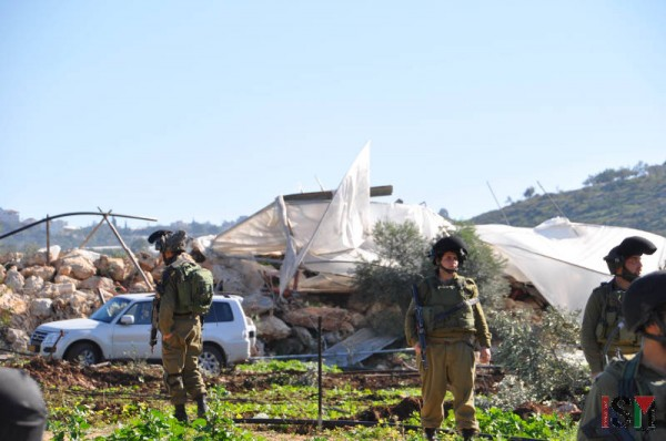 Settlers from the nearby settlements and soldiers watched the scene