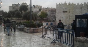 Israeli police stand on both sides of the Damascus Gate exit, in the Palestinian neighborhood.