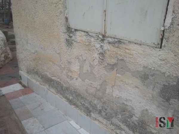 These cracks appeared when the Israeli army bulldozed the land to build the Apartheid Wall.