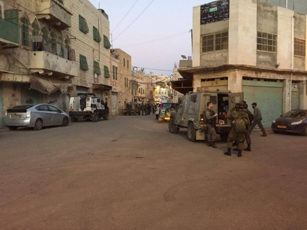 Al-Sahla street 21st of January. Settlers partying in the other end surrounded by soldiers and police.