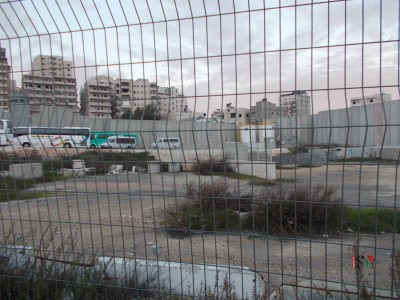 Another view of the Camp, seen through the checkpoint fence