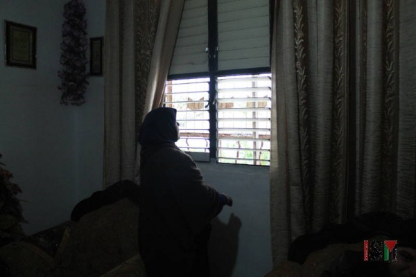 The windows in her house only have shutters, and no glass pains, making it very cold in the winter.