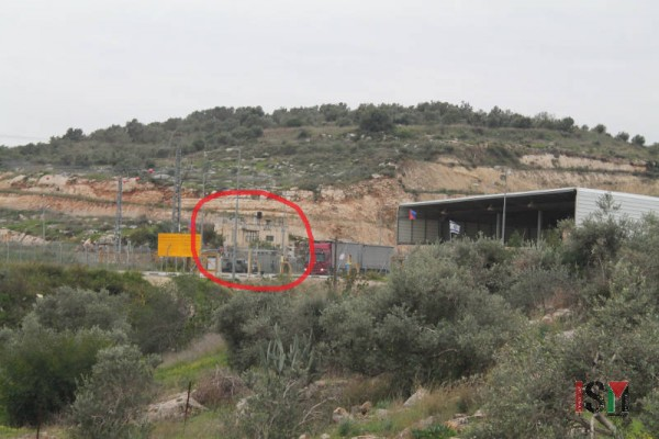 Umm Youssef's home sits alone beside the hill, directly facing the checkpoint.