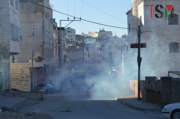 Tear gas clouds lingering in the school-yard and on the streets