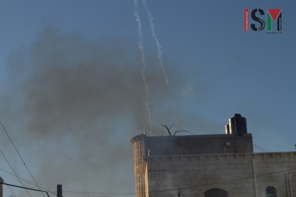 Israeli forces shooting tear gas canisters at students