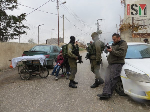 Students forced to pass Israeli army and settlers on their way to school