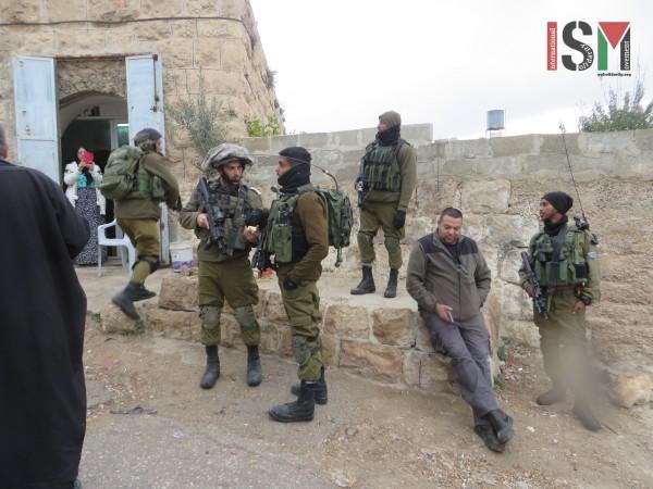 Israeli forces and settler right opposite the school gate