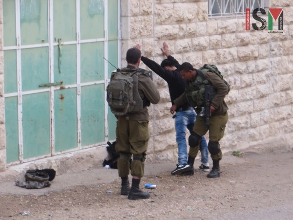 Student body-searched by Israeli forces outside the school