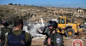 Israeli soldiers raid area with bulldozers to demolish shelters and destroy water tank.