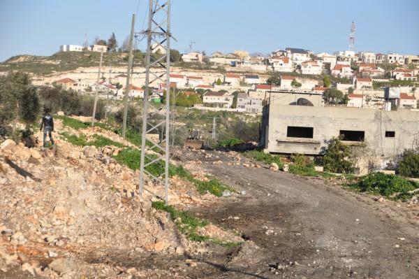Israeli military buldozer enters the village. Kedumim settlement in the background. Photocredtit:ISM