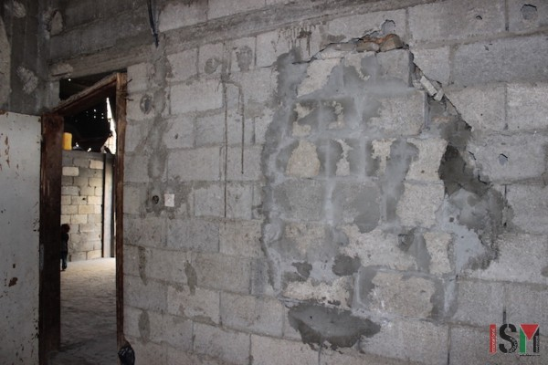 A wall of the family's home, repaired after the bombing