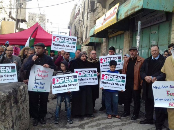 Youth Against Settlement in front of Shuhada checkpoint