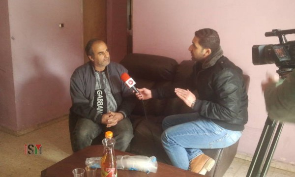 Salah Abukaf talks in an interview for Maan news