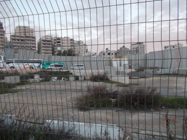 The Shuafat refugee Camp is completely surrounded by an Apartheid Wall and its residents must cross the Shuafat checkpoint in order to access the city of Jerusalem.