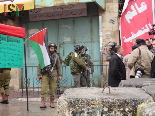 Israeli forces forcing demonstrators back