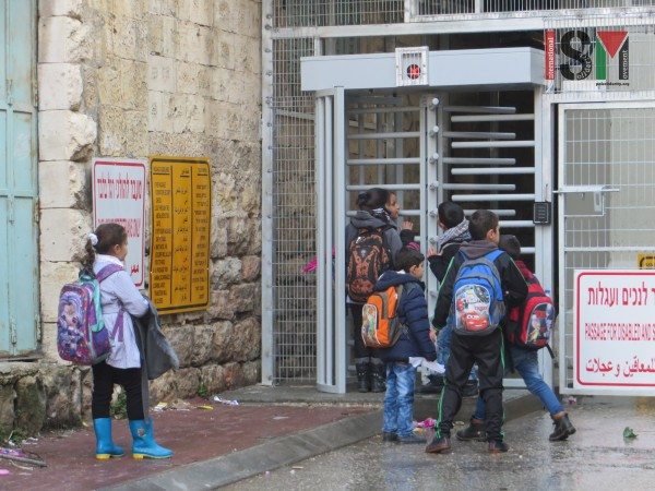School-children forced to wait at Shuhada checkpoint