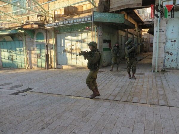 Israeli forces ontheir patrol through the Palestinian market