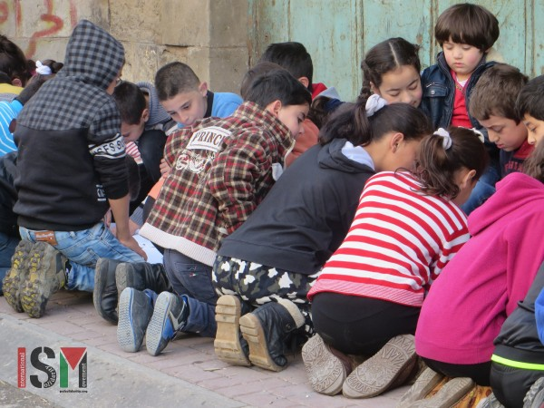 Children drawing during fun-day organised by YAS