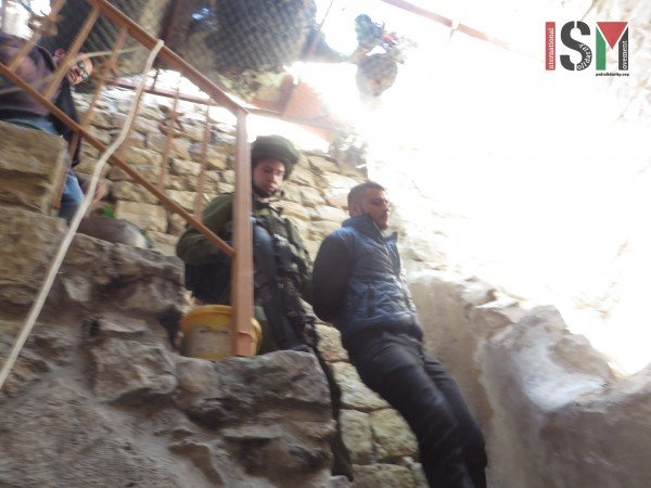 Israeli forces dragging Yusef down the stairs