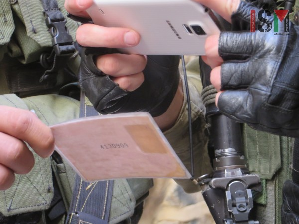Israeli forces photographing Palestinian ID with their private phones