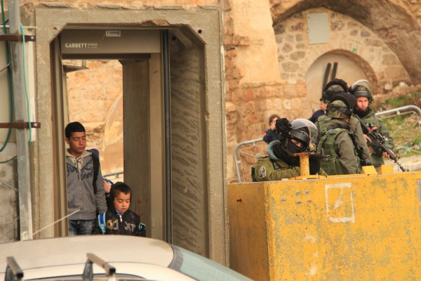 Israeli soldiers targeting Palestinian school children with their assault rifles