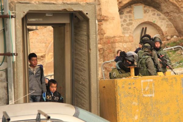 Israeli soldiers targeting Palestinian school children with their assault rifles