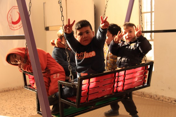 Palestinian school children enjoying the safety of their class room