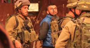 Palestinian arrested by Israeli forces with arm twisted behind his back