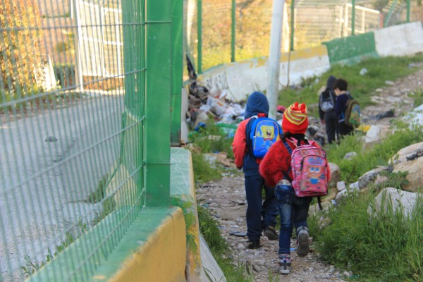 Palestinian kindergarteners are forced to use the dangerous route by Israeli forces