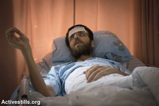 33 year old jopurnalist, Mohammed al-Qeeq, in his hospital bed is today near death.