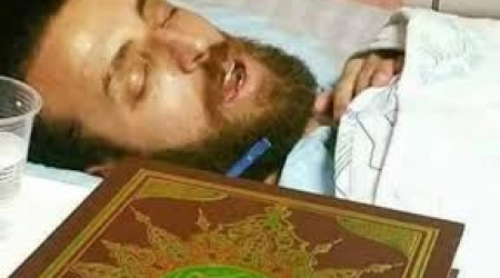 Journalist, Mohammed al-Qiq, in his hospital bed on the brink of death.
