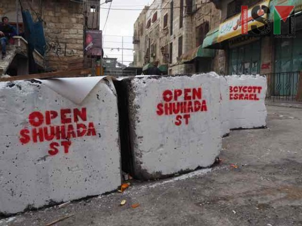 Anti-occupation murals on military blockade