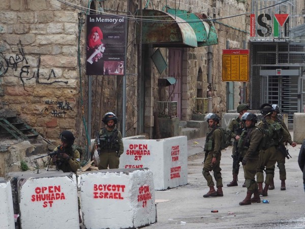 Israeli forces emerging from the checkpoint into supposedly Palestinian controlled H1