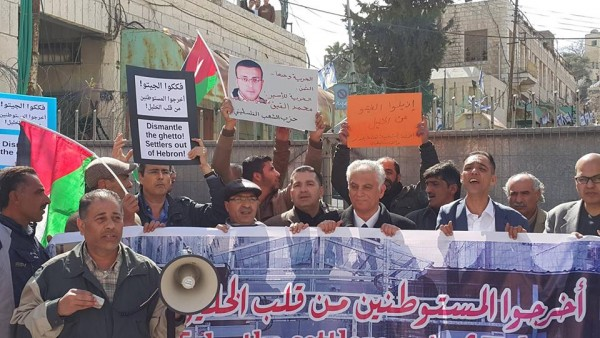 Protestors at the gate leading into Shuhada Street