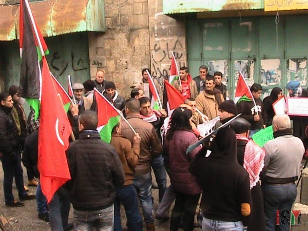 Demonstrators gathered in front of Shuhada checkpoint