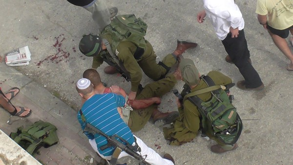 Israeli forces treat the wounded soldier