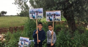Children holding banners commemorating Rachel Corrie