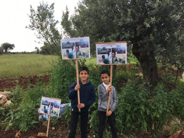 Children holding banners commemorating Rachel Corrie