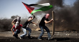 Demonstrators bearing a  Palestinian flag (photo credit 972 magazine)