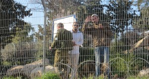 Illegal settlers and Israeli soldier